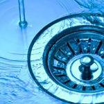 Picture of a water drain vortex with refreshingly clear water draining out of a basin